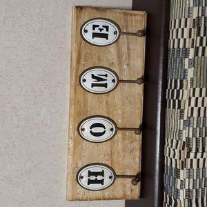 Rustic coat hanger sign